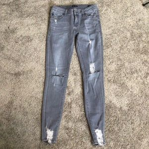 Gray destroyed jeans